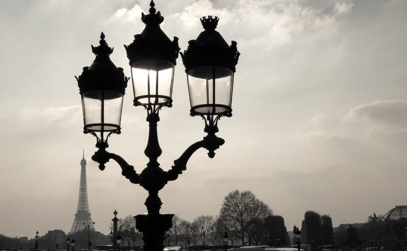 Paris street light and Eiffel Tower in distance